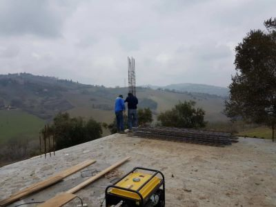 Setting a Corner Column at new house construction site in Le Marche