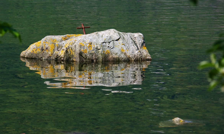 Simple rusty cross on a rock
