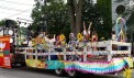 Clam Fest parade float with psychedelic hippes and band, representing Woodstock