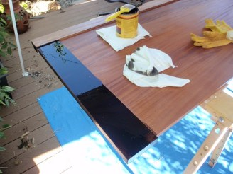First coat of dark walnut stain on African mahogany footboard