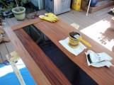 Applying dark walnut stain to African mahigany footboard