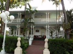 Two two-story Victorian houses with balconies in Key West, FL