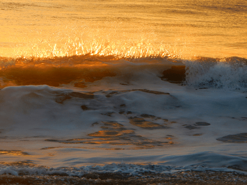 Sunrise turns the Atlantic to gold