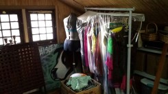 Dressmaker form and old clothes in attic