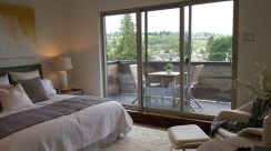 Master bedroom with deck and view of neighborhood