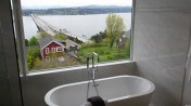 Soaking tub in front of window with Lake Washington view