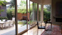 Sliding glass doors in living room open onto courtyard