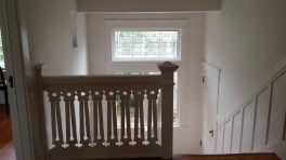 Decorative stairwell railing and leaded glass window