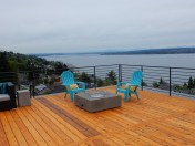 Expansive deck with Adirondack chairs and Lake Washington view