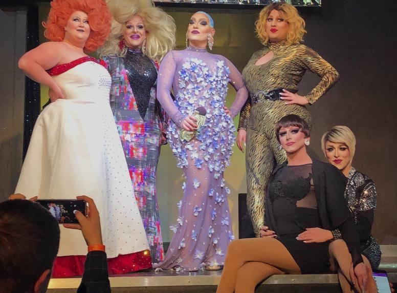Standing: Fiona Fierce, Loring Mitchell, Victoria DeVille and Carmen Love. Sitting: Bad Karma and Mari Jane