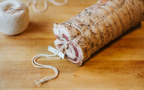 Pancetta cured, rolled, trussed and ready to hang to dry