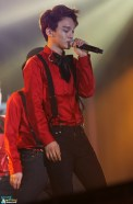 Chen in a red shirt with a black bow tie and suspenders