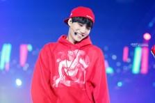 Kai in a red graphic sweatshirt