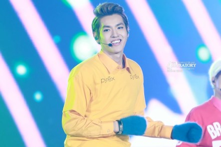 Kris in a yellow shirt with green gloves