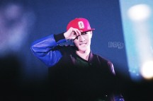 Yixing in black and blue mix leather jacket with a red cap