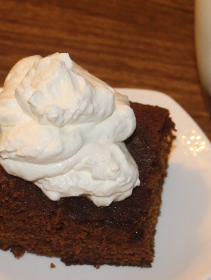 piece of gingerbread with whipped cream