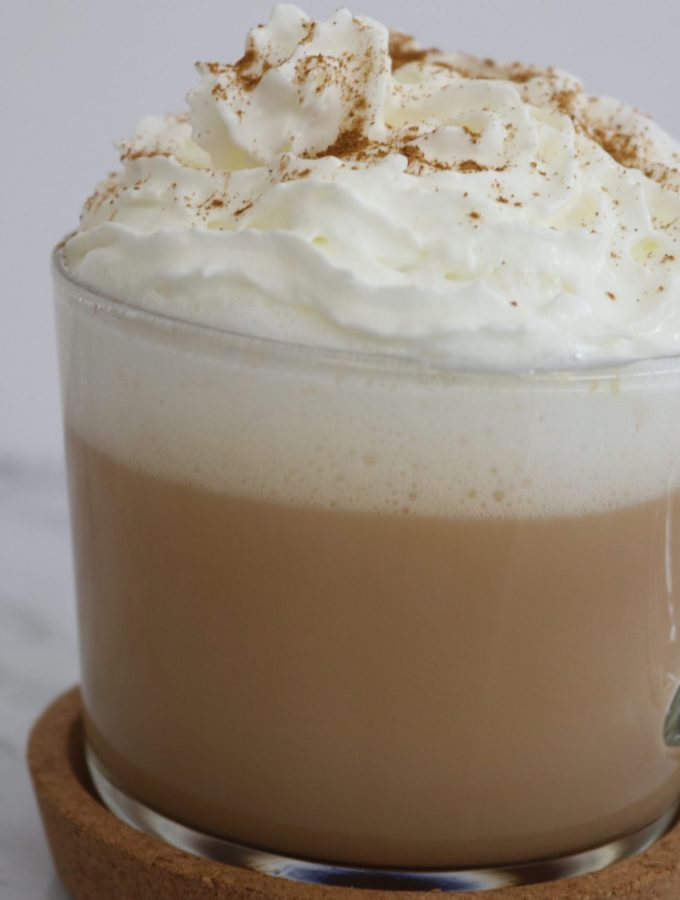 Chi tea latte with whipped cream and cinnamon