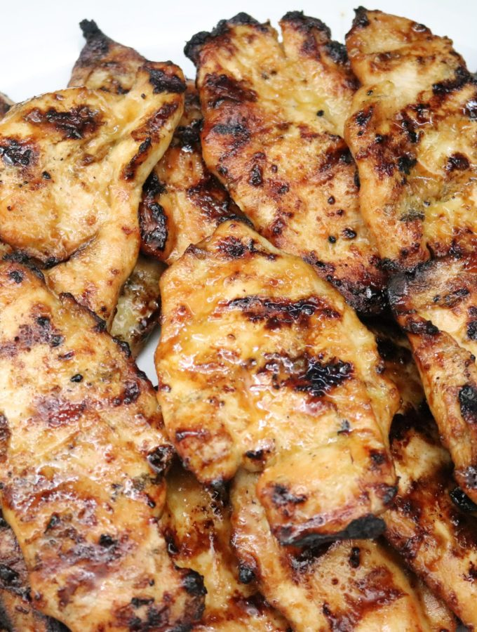 Marinated grilled chicken on a plate
