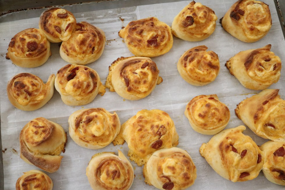 Cooked pizza pinwheels on cookie tray