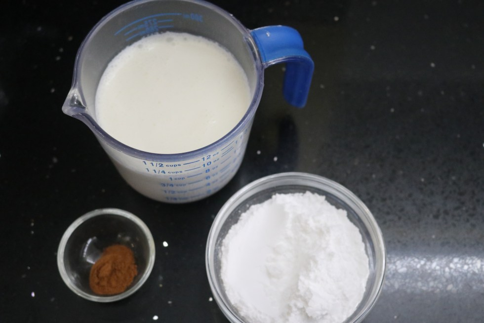 Ingredients for cinnamon whipped cream. 1 cup of cream, sugar and cinnamon.