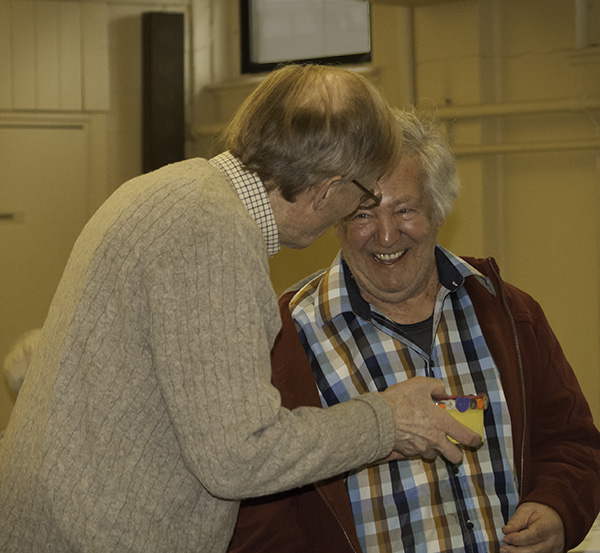 Volunteer Peter Woodruff receives his special button box from Bob