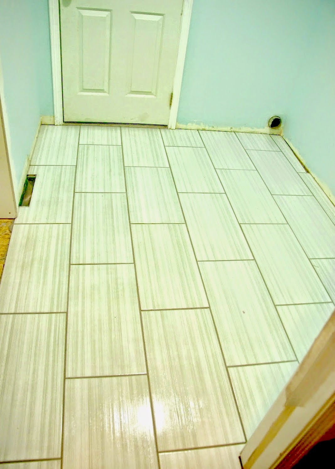 tiling the laundry room our house now