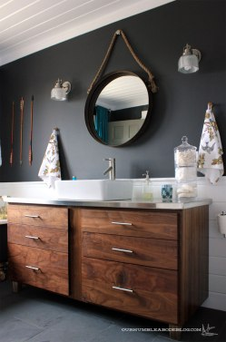 Build a custom wood vanity: https://ourhumbleabodeblog.com/2014/01/29/dark-and-handsome/