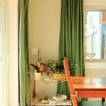 Green Curtains In Dining Room By Plants