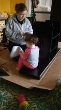 Helping Mommy put together the new shelf