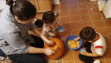Pumpkin carving time! The kids scooped while Mama carved – we made a simple jack-o-lantern face.
