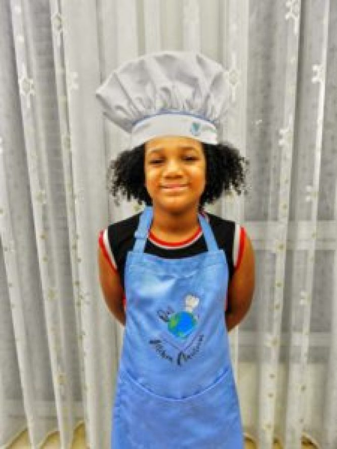 Our Little Sous, Worldschooler Christopher Varnes, wearing his special Our Kitchen Classroom toque and apron in Tirana, Albania