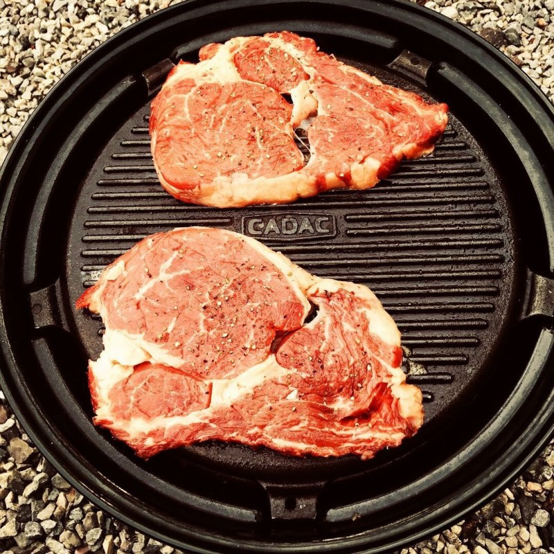Perfect steaks cooking on the cadac