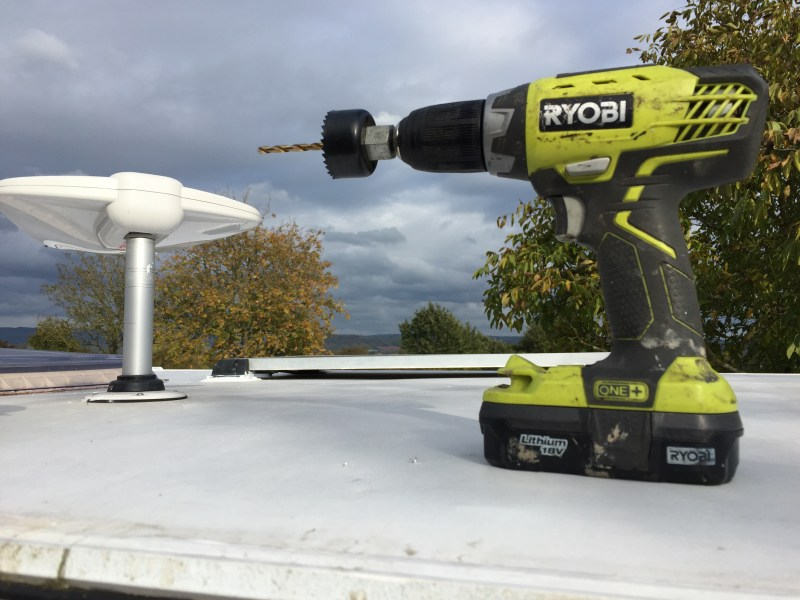 Drill with hole saw ready to make the cutting for the motorhome WiFi mast