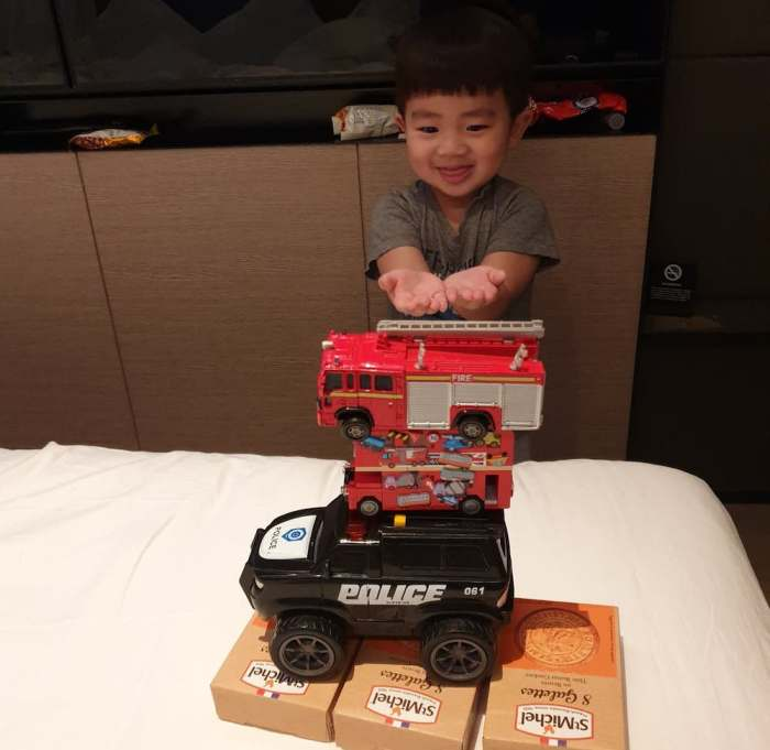 J Boy and his toy cars