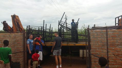 Arriving outside the orphanage with a 10tonne truck and lots of frames like an expensive jigsaw puzzle.