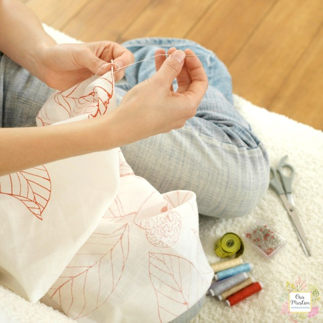 Girl sewing handicraft pillow