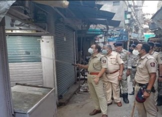 DCP leads foot patrolling in Mominpura, 10 establishments face action