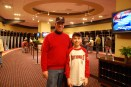 Dad and I standing in the Nationals' locker room in 2010