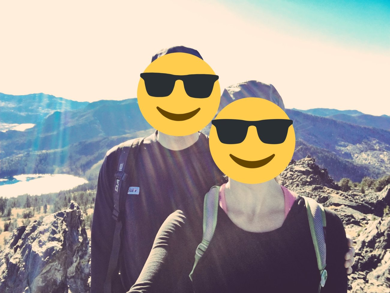 Mr ONL and Ms ONL on top of a mountain... with emoji faces (for now).