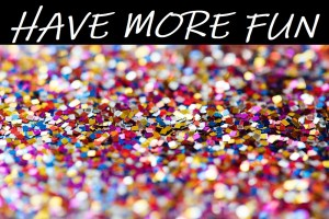 Background photo of confetti with words Have More Fun across the top