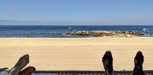 Beach scene two sets of feet shown