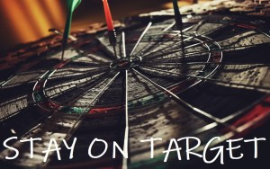 "Photo of dartboard with the words ""Stay On Target"""