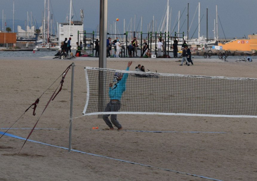 Guy practicing beach tennis