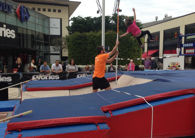 Mostly kids tried out this shopping mall promotion of pole vaulting. No records were set, but it sure looked like fun.
