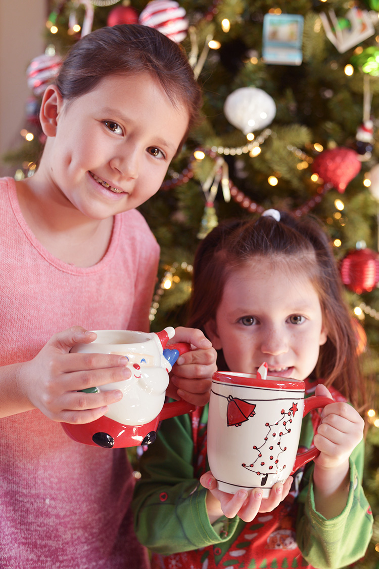 christmas kids enjoying hot cocoa