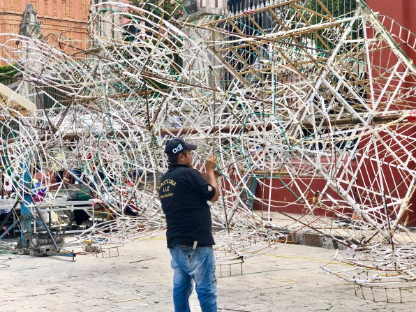 A very intricate fireworks tower takes days to assemble. Quite a skill.