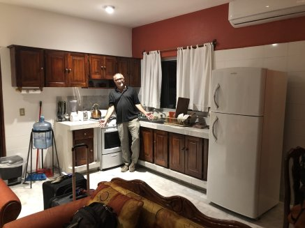 Glenn in kitchen area of apartment