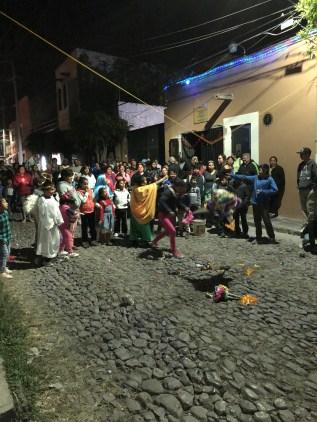 Posada weaves through the street