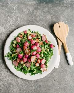 Roasted radishes are sweet, tender and juicy. While perfect on their own with a little butter and salt, they really shine in a warm grain salad tossed with mint salsa verde.