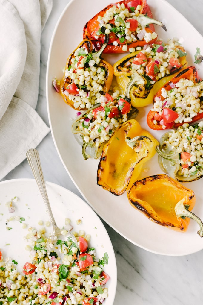 These grilled mexican street corn stuffed peppers are a fast, easy, no-oven-required recipe. They are packed with veggies (and flavor!) and make for a delicious light lunch, or easy side dish. Stretch this dish even further by adding a few cups of cooked black beans to the filling.